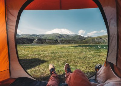 View from inside a tent on the mountains in Elbrus. Travel Destination Hiking Adventure Concept
