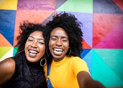 Afro women descent taking selfie photos in the park